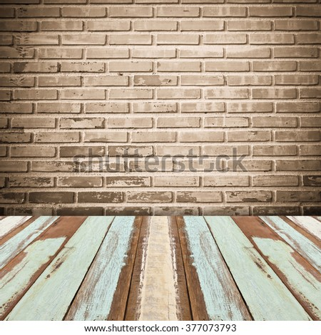 old interior  room with brick wall and wood floor - stock photo