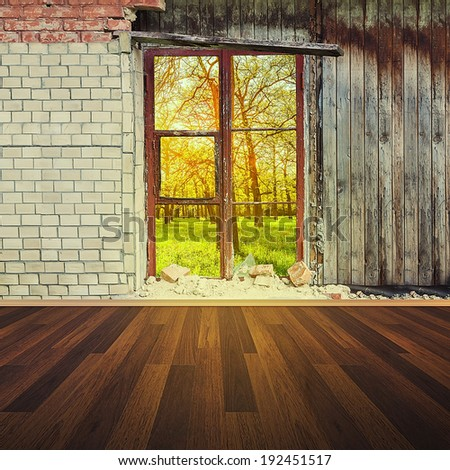 old interior with brick wall and window overlooking the sunny park - stock photo