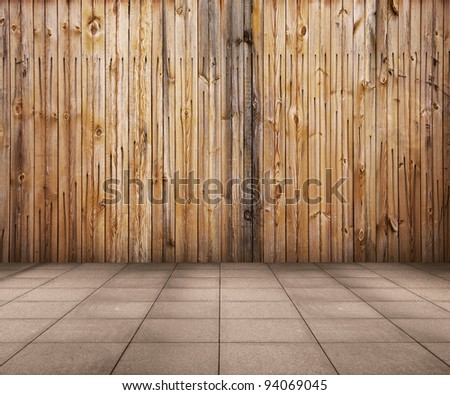 old interior with wooden wall and tiled floor, vintage background - stock photo