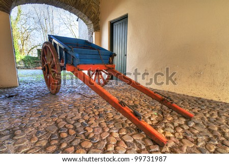 Old Irish cottage cart in the gate - stock photo