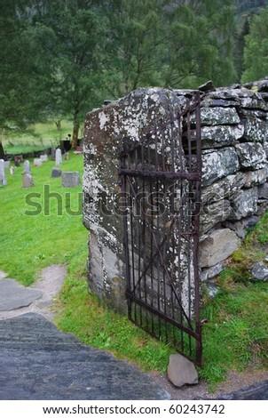Old iron cemetery gate - stock photo