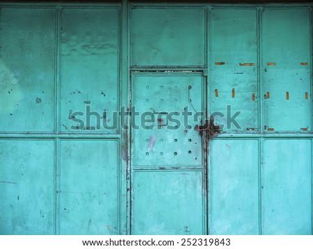 Old iron door, blue-green - stock photo