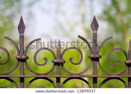 Old iron fence on a natural background. Close-up. - stock photo