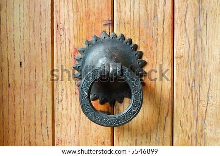 Old iron handle in wooden door. - stock photo