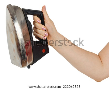 Old iron in a female hand isolated on white background - stock photo