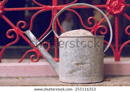 old iron watering can - stock photo