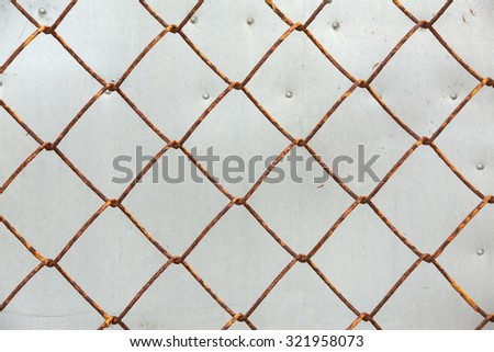 Old iron wire fence, close-up wire mesh fence - stock photo