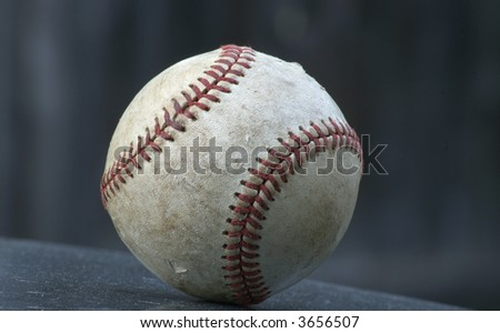 old isolated baseball against a dark background - stock photo