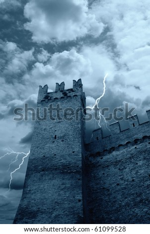 old jail under cloudy sky - stock photo