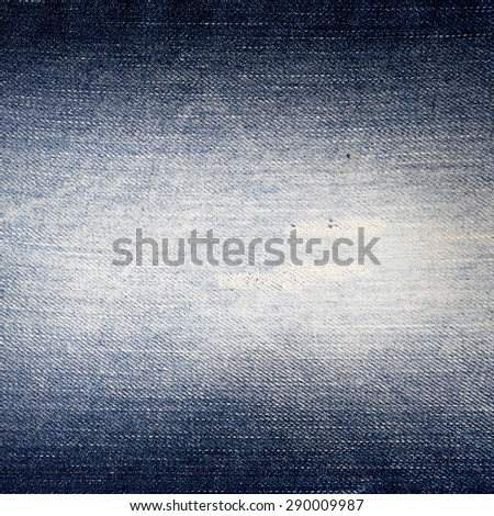 old jeans texture background, frayed fabric texture and vignette - stock photo