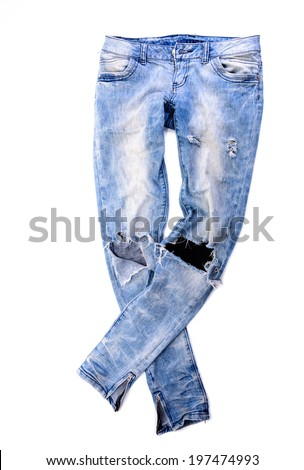 Old jeans trousers isolated on white background - stock photo