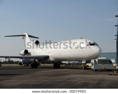 Old jet airplane converted to cargo use - stock photo