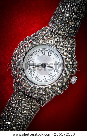 old jewelry watch on red velvet background - stock photo