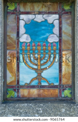 Old Jewish cemetery. Memorial stained glass window - stock photo