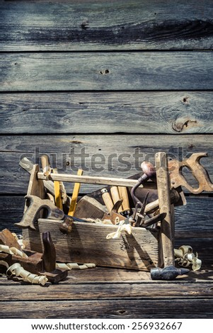 Old joinery box with tools - stock photo