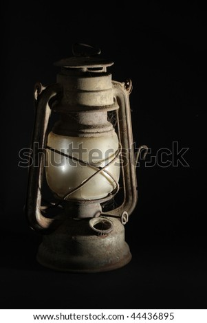 Old kerosene lamp isolated over black background - stock photo