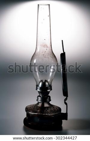 old kerosene lamp with mirror isolated on white background - retro - stock photo