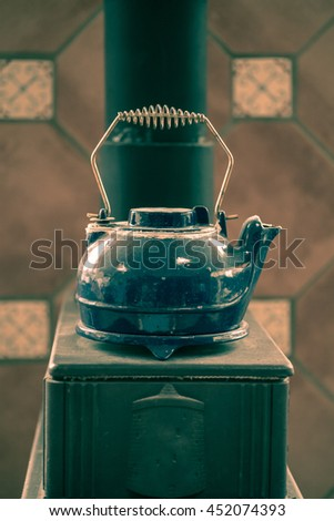 old kettle on charcoal grills, Kettle on the stove, Still life style. - stock photo