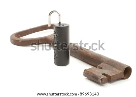 Old key and modern castle - stock photo