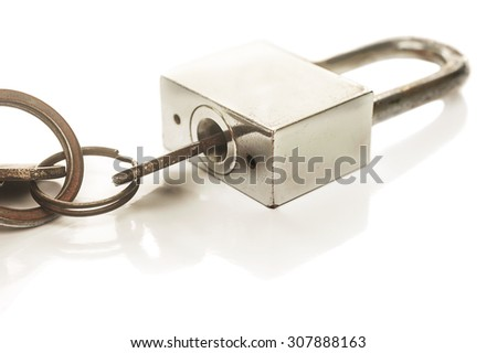Old key in the master key isolated on white background, Selective focus - stock photo