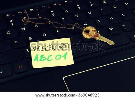 Old key on the keyboard - Internet security - stock photo