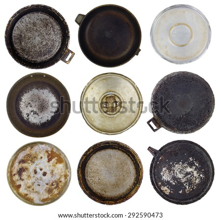 Old kitchen burned-down frying pans set. Isolated abstract collage - stock photo