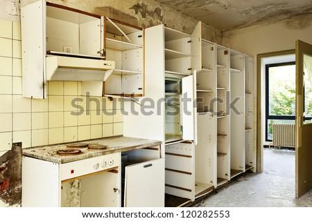 old kitchen destroyed, interior abandoned house - stock photo