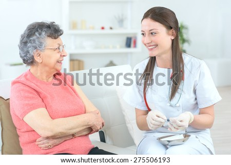 Old lady having her jabs - stock photo