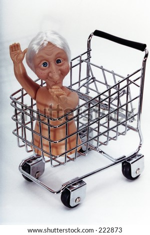 Old Lady in a Shopping Cart - stock photo
