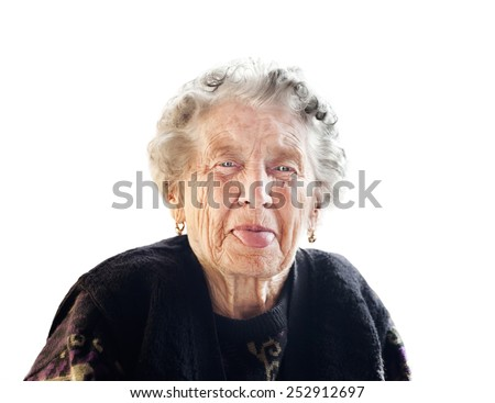 old lady puts out her tongue  on an isolated background - stock photo