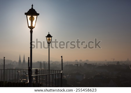 old lamp posts above city  - stock photo