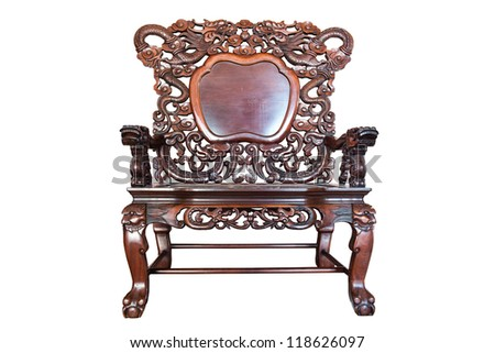 Old large wooden polished chinese chair with brown patterns, isolated in white - stock photo
