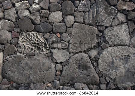 Old lava stone wall - stock photo
