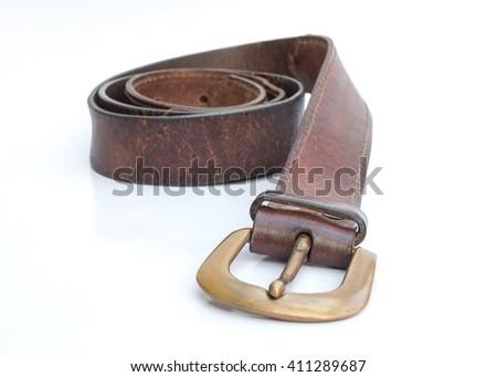 Old leather belt on white background. - stock photo