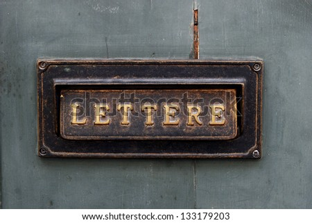 old letter box on the door in Italy - stock photo