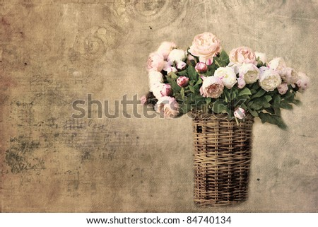 Old letter paper background with roses in basket,romantic card with copy space - stock photo