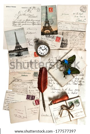 old letters, accessories and postcards. sentimental vintage travel background with antique clock, feather pen and butterfly - stock photo