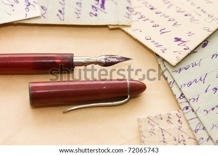 Old letters and pen as a background - stock photo