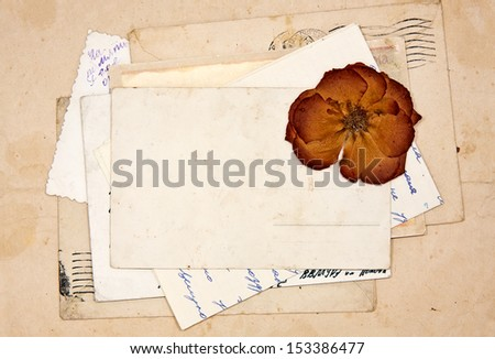 old letters, empty post cards and dried rose, vintage background - stock photo