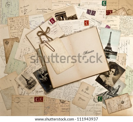old letters, french post cards and empty open book. nostalgic vintage background - stock photo