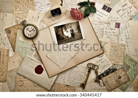 Old letters, photographs and postcards. Nostalgic vintage wedding background. Retro style toned picture - stock photo