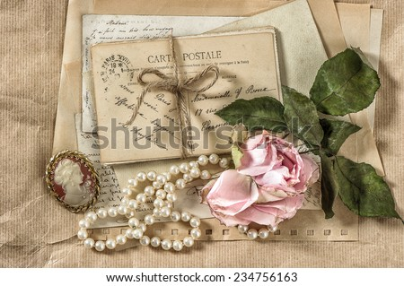 old letters, postcards and vintage things. nostalgic paper background with dry rose flower - stock photo