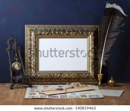 Old letters , vintage frame and a quill pen - stock photo
