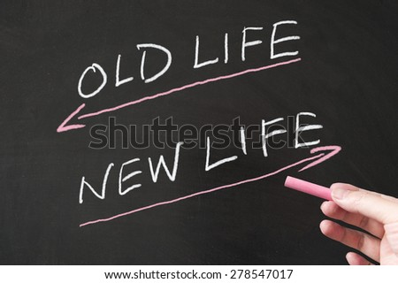 Old life vs new life words written on the blackboard using chalk - stock photo