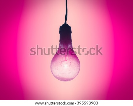 Old light bulb. Photo spot focus and process gradient pink color style. - stock photo