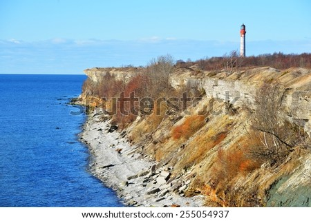 Old lighthouse on the cliffs of Paldiski, Estonia. The Baltic sea - stock photo