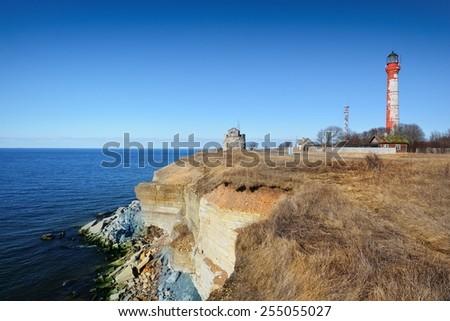 Old lighthouse on the cliffs of Paldiski, Estonia. The Baltic sea - stock photo