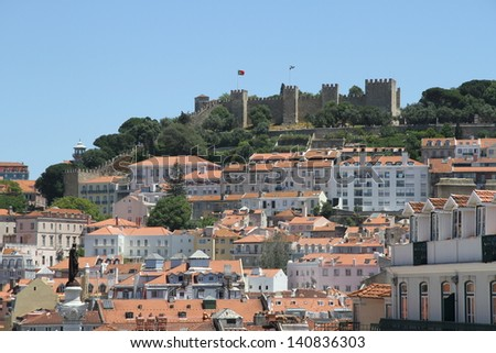 Old Lisbon with view on ancient Fortress: Castle of S�£o Jorge - stock photo