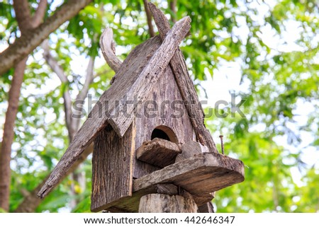 Old Little Birdhouse in Spring forest or garden. - stock photo
