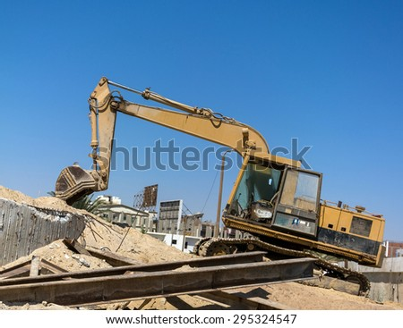 Old Loader at a construction site - stock photo